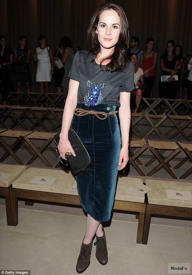 Arm candy! Downton's Michelle Dockery surrounds herself with some …