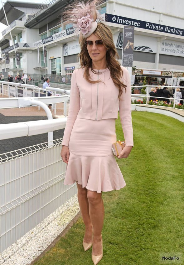 Elizabeth Hurley flashes her pins in frilly skirt as she dons …