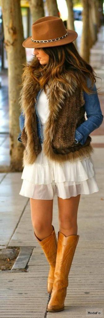 Modern hippie blue jean jacket and boho chic fur vest over gypsy …