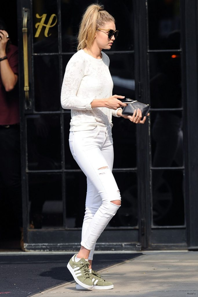 gigi-hadid-in-ripped-jeans- …