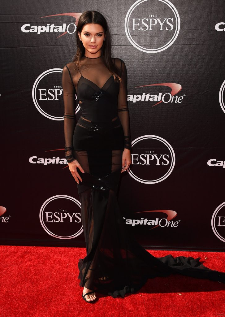Kendall Jenner wore a black long sleeve dress with sheer details ...